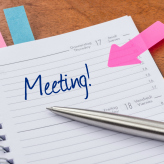 Daily planner with the entry Meeting